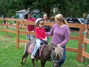 Picture of a youth riding and learning others care.