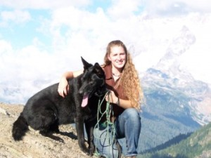 Photo of Stacy Just with her rescued dog, Bear.
