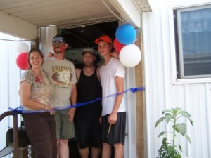 Picture of Grand Opening's cutting the ribbon.