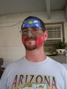 Picture of Jason with face painted red, white, and blue.