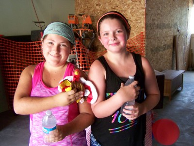 Picture of two girls with their stuffed animal prizes.