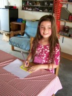 Picture of girl doing stencil drawing.