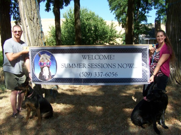 Picture of us holding up a banner about our summer program.