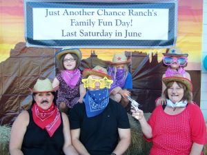 Picture of a family of 6 dressing up in western play clothes.